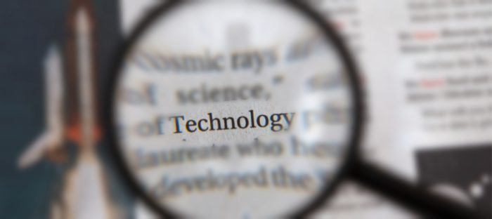 technology magnifying glass on document