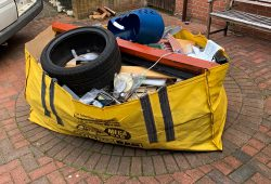 hippo skip bag with waste and tyre