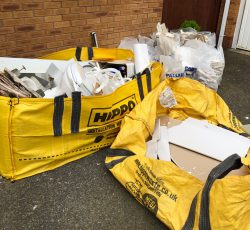 two yello hippobag skip bags filled with plasterboard waste