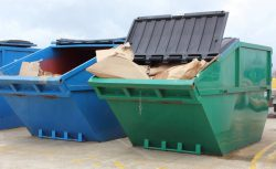 front loader skip filled with cardboard waste