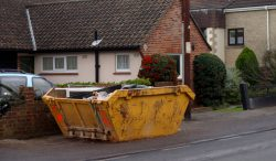 yellow skip on pavement