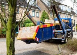 skip lorry lowering skip onto road