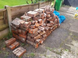 trade waste collection bricks stacked in a pile
