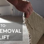 how to uplift and remove carpet full guide picture of man pulling up cream carpet and underlay padding