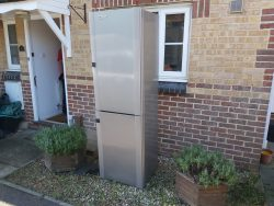 household fridge left outside of house ready for collection and disposal