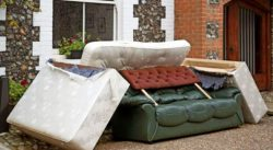 bulky waste sofa and mattress outside of house