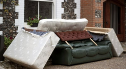 bulky waste mattresses and sofas left outside house for collection and disposal